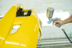 Spray paint, yellow front bumper royalty free stock images