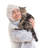 Man in protective clothing holding a cat, isolated Royalty Free Stock Images