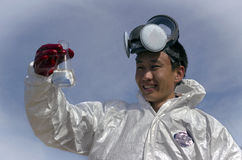 Man in protective clothing. And a mask control pollution Royalty Free Stock Photos