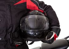 Man in protective gear with his motorbike Stock Images