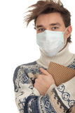 Man in protective mask with book Royalty Free Stock Photo