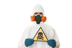 Man in protective suit. A mask and a respirator. Holds a sign with a skull. Isolated on white Royalty Free Stock Image