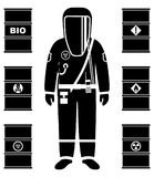 Industry concept. Black silhouette of worker in protective suit. Metal barrels for oil, biofuel, explosive, chemical Stock Photo