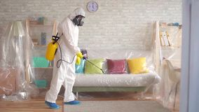Man carries out pest control slow mo