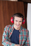 Man with protectors hearing Stock Image