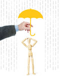 Man protects another person from worries by covering him with an umbrella Royalty Free Stock Photo