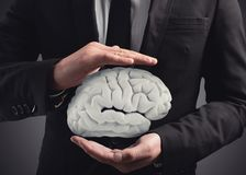 Man protects a brain with his hands. 3D Rendering Royalty Free Stock Photos
