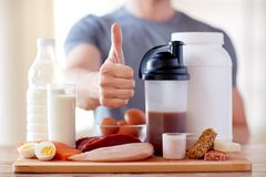 Man with protein food showing thumbs up Stock Photography