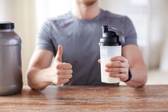 Man with protein shake bottle showing thumbs up Royalty Free Stock Images