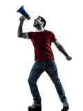 Man protestor angry with megaphone  silhouette Royalty Free Stock Images