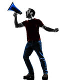 Man protestor angry with megaphone  silhouette Stock Image
