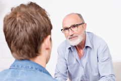 Man at the psychologist Stock Image