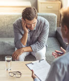 Man at the psychotherapist Royalty Free Stock Photography