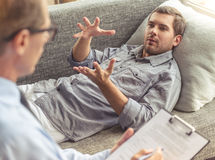 Man at the psychotherapist Stock Photography