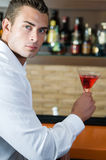 Man in a pub with red martini Royalty Free Stock Photography