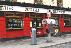 Man walks along a pub in Temple Bar District,Dublin,Ireland Royalty Free Stock Photo