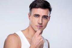 Man pucking nose hair with tweezers Royalty Free Stock Photos