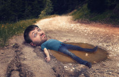 Man in the puddle Royalty Free Stock Photos