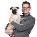 Man with a pug dog Stock Photos