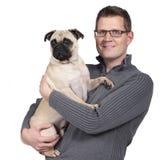 Man with a pug dog Stock Photos