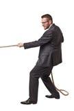 Man pull rope Stock Photo