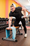 Man pull up barbell fitness training. At gym Stock Images