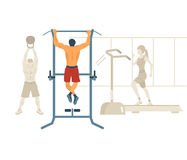 Man pull-up up on horizontal bar in gym Stock Photos