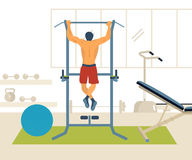 Man pull-up up on horizontal bar in gym Royalty Free Stock Photography