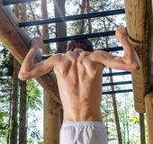 Man pull-ups on a bar Royalty Free Stock Photos
