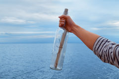 Man pulled out a bottle with a letter from water Stock Images