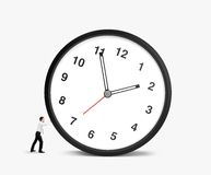 Man pulling clock Stock Images