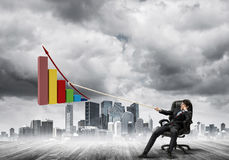 Man pulling with effort big pulling rope graph, as a symbol of financial growth Stock Images