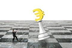 Man pulling Euro symbol of money chess on chessboard Royalty Free Stock Photo