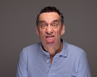 Man Pulling Face Sticking Out Tongue Stock Photography