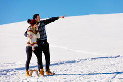 Man pulling girl on a sled at snow - concept: Winter fun Stock Images