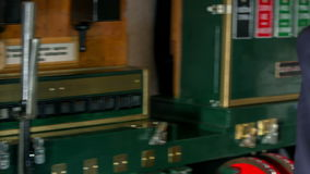 Man pulling the handle on a vintage train control. Close up RAW footage of a conductor pulling the leverage on a vintage train control on a train station stock video