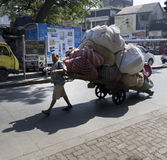 Man pulling a heavy loaded cart, Mumbai Royalty Free Stock Images