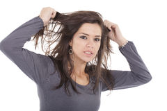 Man pulling her hair Stock Image