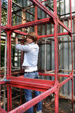 Man pulling himself up on metal constructions. In city Royalty Free Stock Photography