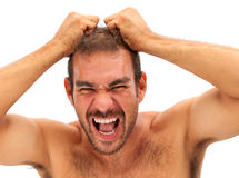 Man pulling his hair and yelling Stock Image