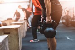 Man pulling kettlebells weights in the functional fitness gym Royalty Free Stock Photos