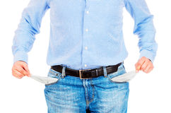 Man pulling out empty pockets. Photo of a man pulling out empty pockets Stock Photos