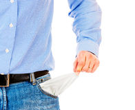 Man pulling out empty pockets Stock Image