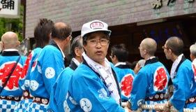 Man pulling a portable shrine. Mount Koya, Japan - June 14, 2011: Man pulling a portable shrine during Aoba festival, an annual event celebrating the birthday of Stock Photo