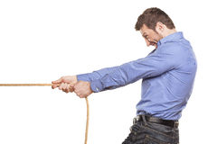 Man pulling rope Stock Photos
