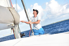 Man pulling rope of sailing boat Royalty Free Stock Photo