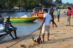 Man pulling ship anchor Royalty Free Stock Photo