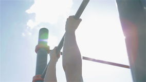 Man pulling up outdoors. The sun glare stock footage