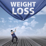 Man pulling weight loss banner 1 Royalty Free Stock Photo