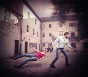 Man pulling woman by the hair. Angry men pulling women by the hair on the road Royalty Free Stock Photo